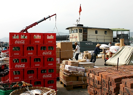 Unloading a cargo boat in Cheung Chau harbour